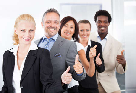 Photo for Group Of Happy Multiracial Businesspeople Standing In A Row - Royalty Free Image