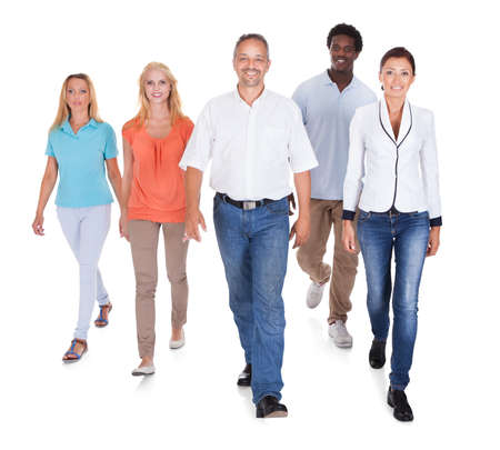 Happy Casual Group Of People Standing Over White Background