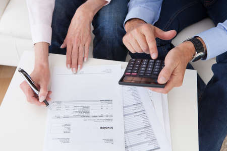 Photo for Close-up of mature couple doing finances at home - Royalty Free Image