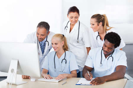 Photo for Group Of Happy Multiracial Doctors Working Together In Clinic - Royalty Free Image