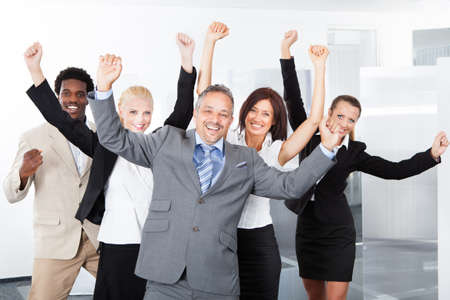 Photo for Group Of Multiracial Businesspeople Enjoying Their Success - Royalty Free Image
