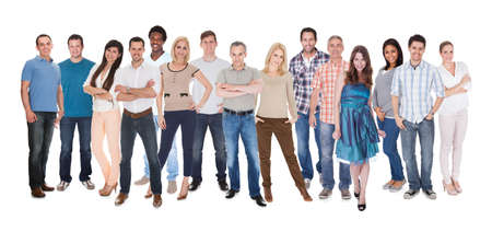 Happy Group Of People Dressed In Casual Standing Over White Background