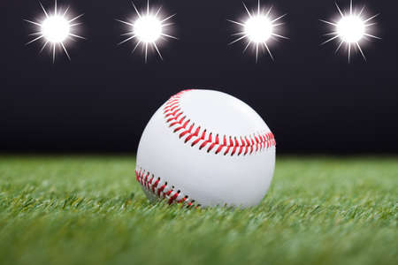Baseball On Grass Field With Light In The Background