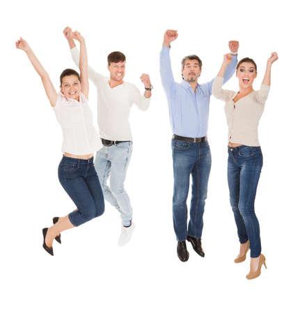 Photo pour Group Of A Happy Friends Standing Over White Background - image libre de droit