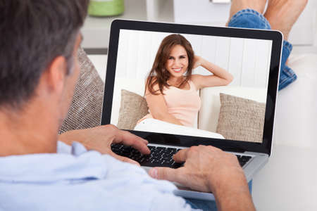 Photo for Close-up Of A Man Chatting With Woman Using Laptop - Royalty Free Image