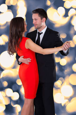 Foto de Portrait Of Happy Young Couple Dancing On Bokeh  - Imagen libre de derechos