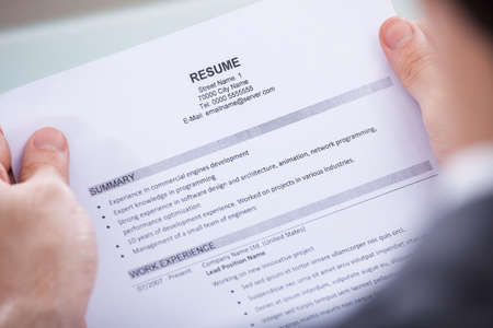 Photo for Close-up Of Photo Business Person Holding Resume - Royalty Free Image