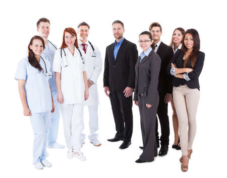 Photo pour Large ground of doctors and managers over white background - image libre de droit