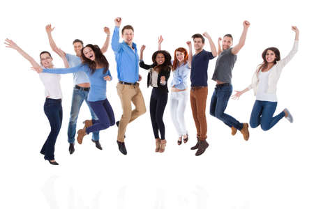 Photo for Group of diverse people raising arms and jumping. Isolated on white - Royalty Free Image