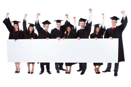 Photo for Cheerful excited graduate students showing empty banner. Isolated on white - Royalty Free Image