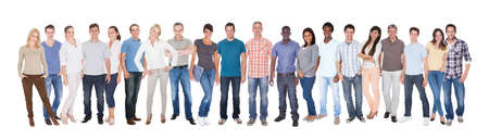 Panoramic shot of diverse people in casuals standing against white background