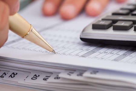 Photo for Cropped image of businessman checking expense in office - Royalty Free Image