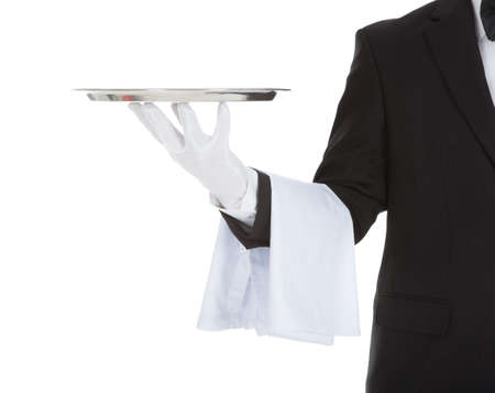 Photo pour Cropped image of waiter holding empty tray over white  - image libre de droit