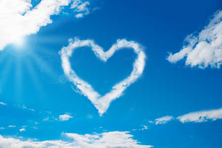 Foto de Low angle view of heart shaped cloud in blue sky - Imagen libre de derechos