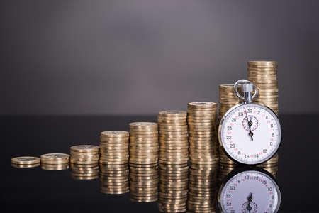 Photo pour Time is money concept over black background - image libre de droit