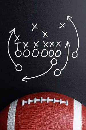 Foto de Football Play Strategy Drawn Out On A Chalk Board With Rugby Ball - Imagen libre de derechos