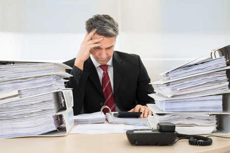 Photo pour Photo Of Contemplated Businessman Working At Office - image libre de droit