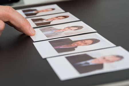 Photo for Close-up Of A Person's Hand Choosing Photograph Of A Candidate - Royalty Free Image