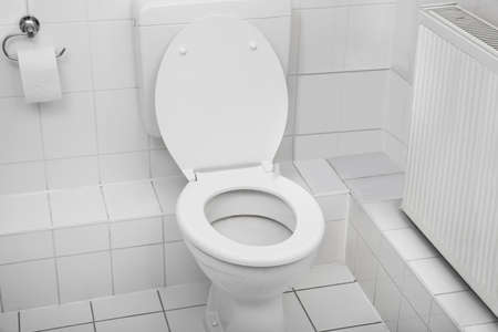 Foto de White Toilet Bowl In A Clean Hygienic Bathroom - Imagen libre de derechos