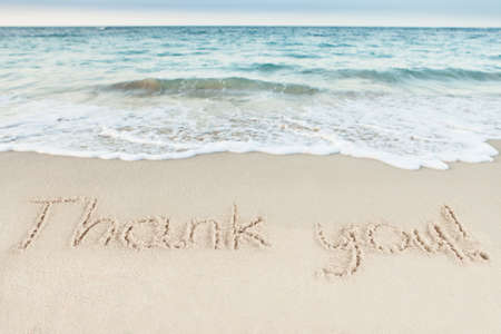 Foto de Thank you written on sand by sea at beach - Imagen libre de derechos