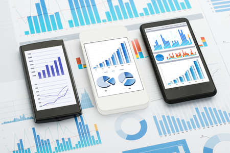 Mobile Phones With Analytics Graphs And Charts