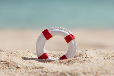 Photo for Close-up Of Miniature Lifebuoy On Sandy Beach - Royalty Free Image