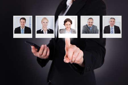 Photo pour Close Up Of A Man Selecting A Profile Picture On Digital Screen - image libre de droit