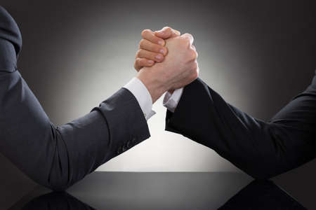 Photo for Close-up Of A Two Businessman Competing In Arm Wrestling - Royalty Free Image