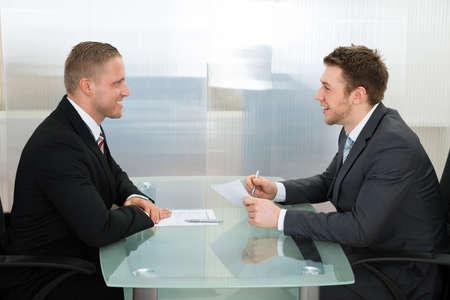 Photo pour Happy Young Businessman Conducting An Employment Interview In The Office - image libre de droit