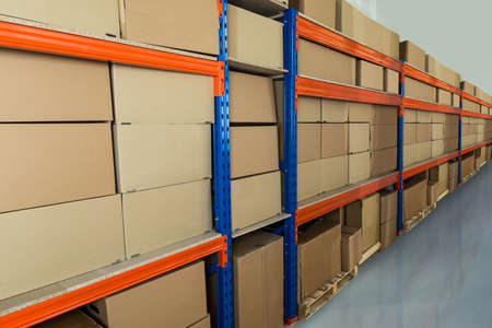 Photo for Cardboard Boxes On Shelves In Distribution Warehouse - Royalty Free Image