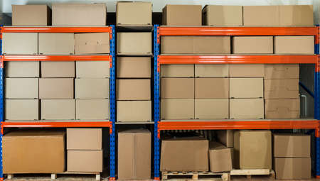Foto de Cardboard Boxes On Shelves In Distribution Warehouse - Imagen libre de derechos