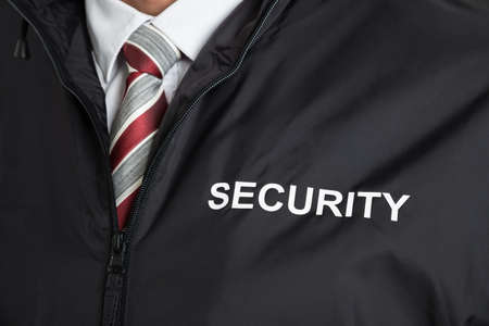 Foto für Close-up Of Security Guard Wearing Uniform With The Text Security - Lizenzfreies Bild