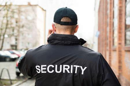 Foto de Close-up Of Male Security Guard Wearing Black Jacket - Imagen libre de derechos