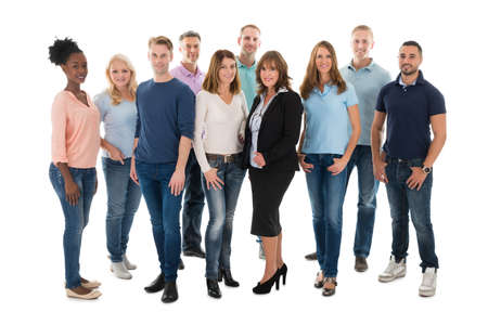 Photo pour Group portrait of creative business people standing together over white background - image libre de droit