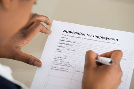 Photo for Close-up Of A Woman Filling Employment Form - Royalty Free Image