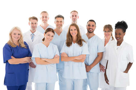 Photo for Portrait of happy multiethnic medical team standing against white background - Royalty Free Image