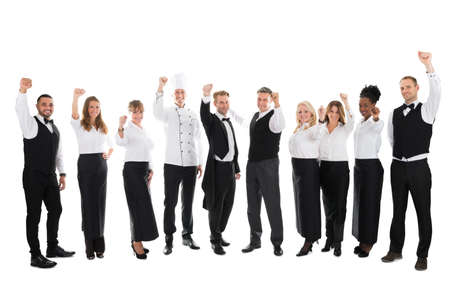 Photo for Full length portrait of happy restaurant staff celebrating success against white background - Royalty Free Image