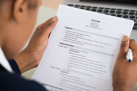 Photo for Close-up Photo Of A Businesswoman Holding Resume - Royalty Free Image