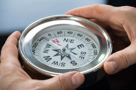 Close-up Photo Of Person Hand Holding Compass