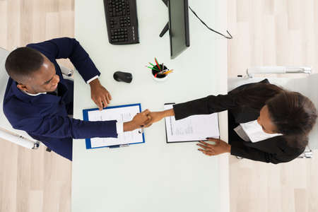 Photo for High Angle View Of Two Businesspeople Shaking Hand - Royalty Free Image
