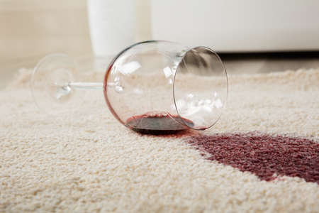 Photo pour High Angle View Of Red Wine Spilled From Glass On Carpet - image libre de droit