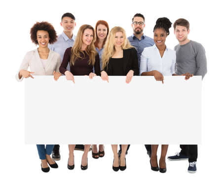 Photo for Group Of Happy Multiracial College Students Holding Long Billboard - Royalty Free Image