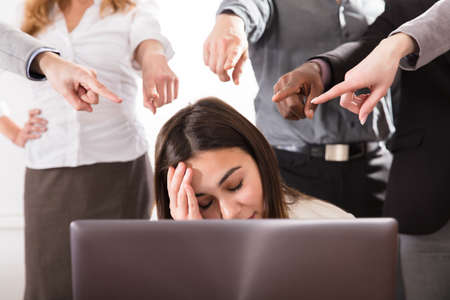 Photo pour Many Hands Pointing The Stress Business Woman At The Workplace - image libre de droit