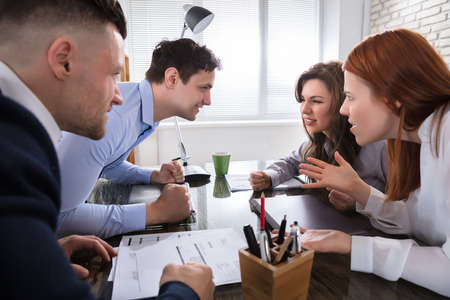 Foto de Business Coworker Arguing To Each Other At Workplace In Office - Imagen libre de derechos