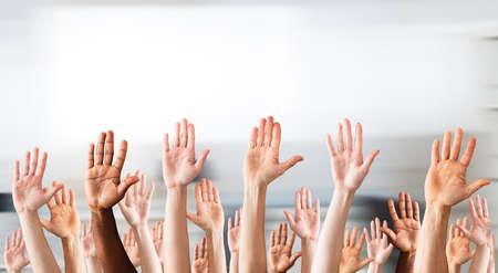 Photo pour Photo Of Crowd Raising Hands High Up - image libre de droit