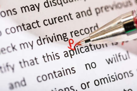 Photo for Correcting Application Word With Red Pen On Manuscript - Royalty Free Image