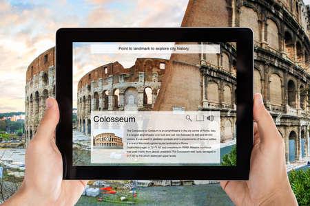Foto de Closeup of tourist taking picture of Colosseum from digital tablet - Imagen libre de derechos