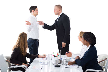 Photo for Boss Shouting On Male Executive In Business Meeting - Royalty Free Image