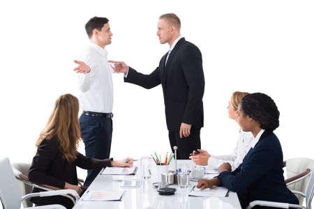 Photo pour Boss Shouting On Male Executive In Business Meeting - image libre de droit