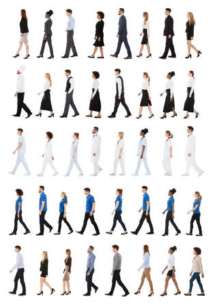 Set Of People With Different Occupations Walking In Line Over White Background